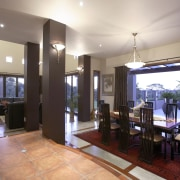 Dining and living areas step down from the dining room, estate, home, interior design, lobby, property, real estate, room, white