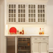 A separate bar area is outside the main cabinetry, countertop, cuisine classique, furniture, home, interior design, kitchen, room, shelving, window, orange, brown