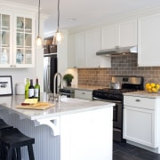 A peninsula forms the centerpiece of this remodeled cabinetry, countertop, cuisine classique, home, interior design, kitchen, room, white, gray