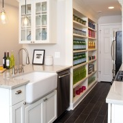 The traditionally styled cabinetry includes an overhead display cabinetry, countertop, cuisine classique, interior design, kitchen, room, white