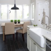 Casual dining space in small traditional kitchen with bathroom, countertop, floor, flooring, home, interior design, kitchen, product design, room, sink, tap, tile, white
