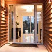 Cedar weatherboards line the entry to this new door, home, interior design, property, real estate, window, brown, orange