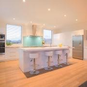 A family-size kitchen provides plenty of work space countertop, floor, flooring, interior design, kitchen, property, real estate, room, orange, gray