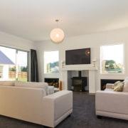 The living room in the new GJ Gardner ceiling, floor, home, interior design, living room, property, real estate, room, gray
