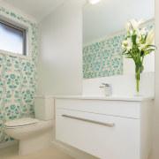 Wallpaper brings a fresh look to this powder bathroom, bathroom accessory, floor, home, interior design, plumbing fixture, room, shelf, sink, wall, white