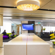 The interactive zone is a showcase for NEC ceiling, interior design, lobby, office, white, orange