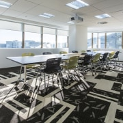 A graphic black and white carpet is a office, structure, gray