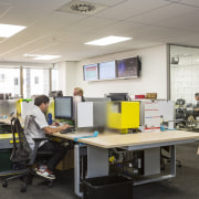 Staff workstations are positioned along benches. - Staff classroom, desk, furniture, institution, job, office, white