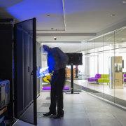 Technology room in the NEC Wellington office designed interior design, technology, black, gray