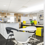 Work areas include high counters, high tables with furniture, interior design, job, office, product design, white