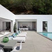 Sun loungers on this pool terrace reinforce the architecture, backyard, estate, home, house, interior design, property, real estate, swimming pool, villa, gray