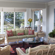 In this remodel, the sunroom features white wicker estate, home, interior design, living room, real estate, room, window, gray