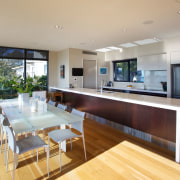 The galley kitchen faces views of the water. house, interior design, kitchen, living room, property, real estate, gray