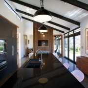 Black cabinets anchor both ends of the kitchen architecture, house, interior design, real estate, black, gray