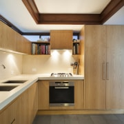 As part of the revamp of this Mid-century architecture, cabinetry, countertop, cuisine classique, interior design, kitchen, real estate, room, wood, orange, brown