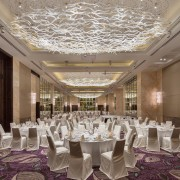 The grand ballroom features custom tubular glass lighting aisle, ballroom, banquet, ceiling, centrepiece, ceremony, function hall, interior design, restaurant, wedding reception, gray, brown