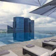The Westin Singapore has a rooftop infinity swimming apartment, architecture, building, condominium, corporate headquarters, daylighting, penthouse apartment, property, real estate, sky, swimming pool, gray