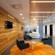 Lighting strips enhance the warm glow of the ceiling, floor, flooring, interior design, lobby, brown, orange