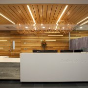 A timber batten ceiling conceals services in the architecture, ceiling, floor, flooring, interior design, lobby, wood, gray, brown