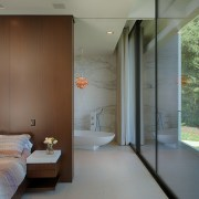 The bedroom and bathroom both enjoy the views architecture, ceiling, door, home, house, interior design, real estate, window, gray, brown