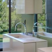 Wading basins are integrated into the vanities on bathroom, bathroom accessory, bathroom cabinet, countertop, interior design, kitchen, sink, gray
