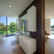 A central wall is the only thing separating architecture, bathroom, daylighting, estate, house, interior design, property, real estate, room, window, gray