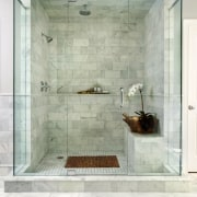 With glass walls on three sides, the front bathroom, floor, flooring, glass, interior design, plumbing fixture, room, shower, tile, wall, gray, white