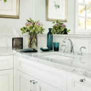 White lacquered cabinets are teamed with Carrara marble bathroom, bathroom accessory, bathroom cabinet, cabinetry, countertop, home, interior design, kitchen, product design, room, sink, tap, white