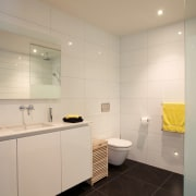High-end fixtures are a feature of the bathrooms bathroom, property, room, orange, gray