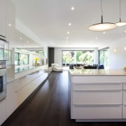 The high-gloss lacquered Poggenpohl cabinetry extends along the countertop, interior design, kitchen, gray