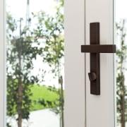 Chant customisable residential door handle in Weathered Brass door, home, window, wood, white
