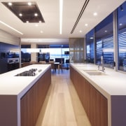 Parallel islands and a matching perimeter unit ensure ceiling, countertop, interior design, kitchen, white