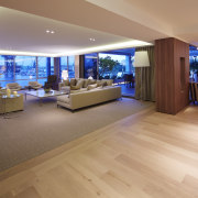 Waterfront apartment with entertainers open-plan living area. Project floor, flooring, hardwood, interior design, laminate flooring, lobby, real estate, wood, wood flooring, orange, brown