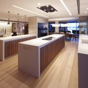 This entertainers kitchen with parallel islands and a countertop, floor, flooring, interior design, kitchen, wood