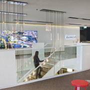 Reception is on the uppermost level of Aurecon glass, interior design, product design, gray