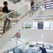 This wide stairwell optimises light flow through the architecture, building, daylighting, glass, handrail, interior design, stairs, gray