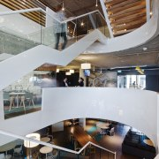 A central stairwell in the Aurecon head office architecture, ceiling, daylighting, interior design, lobby, gray, brown