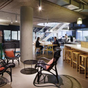 Breakout spaces in the Aurecon office are set café, interior design, restaurant, brown, black