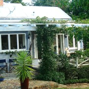 New Zealand traditional villa before renovation arecales, cottage, home, house, outdoor structure, plant, property, real estate, tree, window, green, white