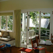 Family living in New Zealand traditional villa before curtain, door, home, house, interior design, living room, real estate, room, textile, window, window covering, window treatment, wood, brown