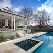 A major renovation by Scarlet Architects has transformed architecture, backyard, cottage, estate, home, house, property, real estate, residential area, swimming pool, villa, window, gray