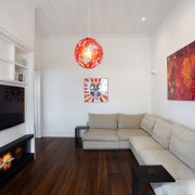 The living room in this remodelled villa can home, interior design, living room, real estate, room, table, gray