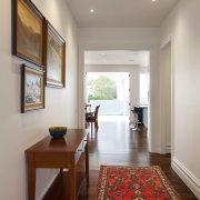 This hallway was widened in a major villa ceiling, floor, flooring, hardwood, home, interior design, living room, real estate, room, window, wood flooring, gray