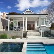 Scarlet Architects redesigned the rear of this traditional architecture, cottage, elevation, estate, facade, home, house, mansion, property, real estate, residential area, sky, swimming pool, villa, window, blue