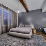 In the colour scheme in this bedroom, grey architecture, bedroom, ceiling, floor, interior design, real estate, room, suite, wall, gray