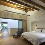 The master suite of this remodelled Singapore shophouse architecture, bedroom, ceiling, daylighting, floor, interior design, real estate, room, suite, wood, brown, gray