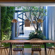 Green carpet grass and a living wall create dining room, furniture, home, house, interior design, living room, real estate, room, table, window, gray