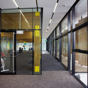 Sliding doors open out to a deck on architecture, building, door, glass, lobby, metropolitan area, real estate, window, gray, black