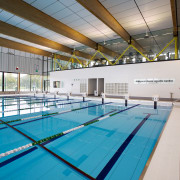 A moveable floor covers a large section of daylighting, indoor games and sports, leisure, leisure centre, sport venue, structure, swimming pool, water, gray, teal