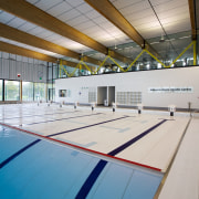 The swimming pool floor can be raised to ceiling, daylighting, floor, flooring, indoor games and sports, leisure, leisure centre, line, sport venue, sports, structure, gray